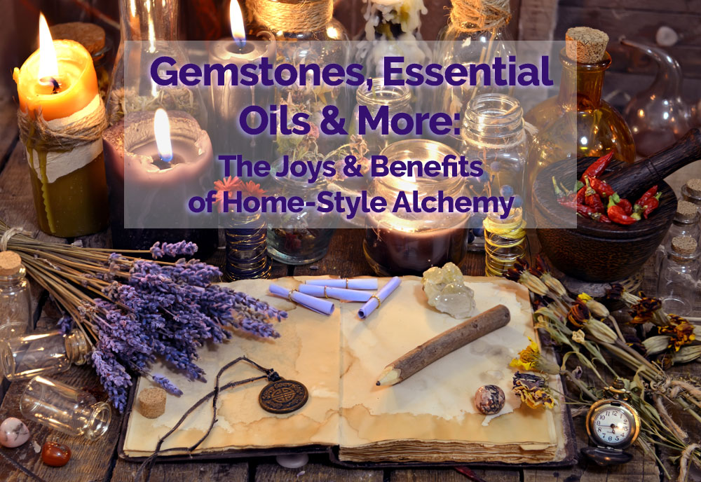 Gemstones, essential oils and herbs on a table for esoteric alchemy